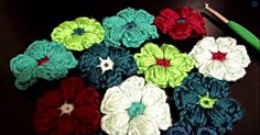 You may have learned how to make a standard flower, but now learn how to make a puff stitch flower!
