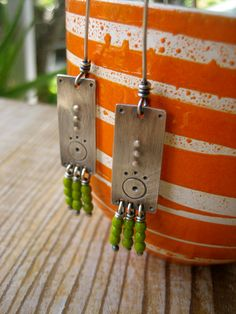 Sterling Silver Rectangle Stamped Textured Long Tab Earrings with Green Glass Beads by Sierra Keylin Jewelry. $45.00, via Etsy.