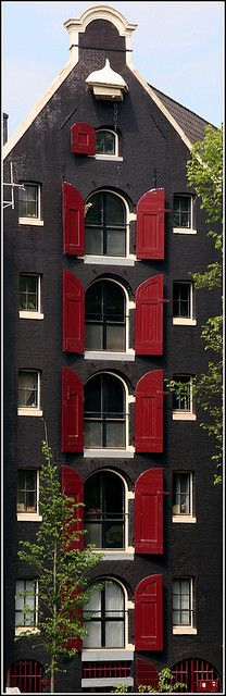 Amsterdam building with red shutters