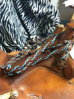 barrel racing reins with grip knots and round hand hold turquoise and brown