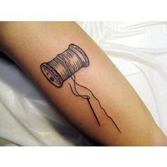 needle and thread tattoo