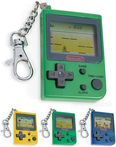 Mini Nintendo Classics Keychains : 1 - Super Mario Bros : Inane leaping between side-scrolling platforms or a nailbiting race to rescue a princess? Probably both. 2 - Donkey Kong Jr : An arcade classic in which you help the son of an ape unlock padlocks by jumping between vines. As you do. 3 - Mario's Cement Factory : This classic platformer sees the iconic tap-twiddler attempting to prevent containers of cement overflowing. Plumber? In a cement factory? Whatever.