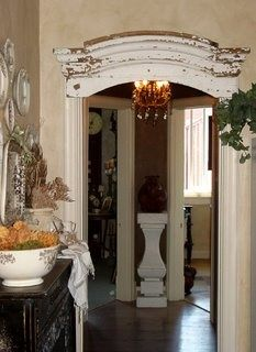 An old door header with transform your space- it's in the details