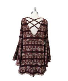 Basically Me trumpet sleeve, criss cross back tribal print dress.
