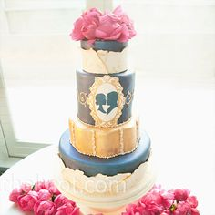 The couple's silhouette motif appeared on the four-tiered cake, with ivory fondant fashioned to mimic the lace on Katrina's gown.