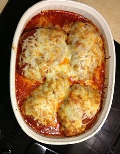Easy Chicken Parmesan. Fry chicken slightly first, then bake at 375 with sauce and cheese until cooked through.