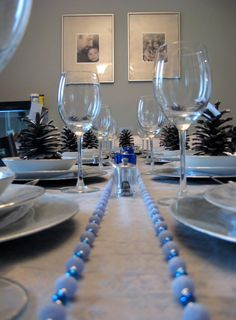 Hanukkah table setting, I like the mini Christmas balls and the pine cones