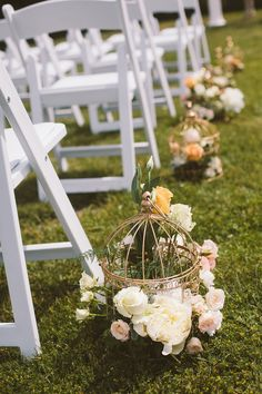 Vintage birdcages lined the aisle and were filled with flowers for a romantic look.  This is a wedding diy project you can do yourself.  Perfect for spring or summer weddings. ♡
