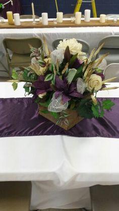 Centerpiece, barn wood, ranunculous, lilies, plum