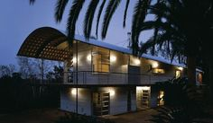 Quonset house - I like the way the roof provides an over hang for the deck