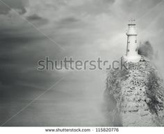 Beautiful fantasy background of a lighthouse on the top of a rocky mountain with…