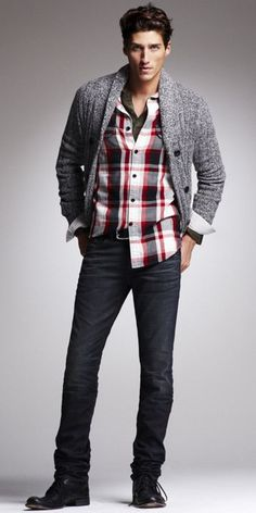 Ever so casual and yet understated stylish look for him. Check shirt, tee and cardigan over slim fit jeans and boots.