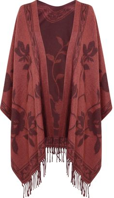 cape for fall 2015 / winter 2016 - read fashion tips for fringe - http://www.boomerinas.com/2015/05/04/7-fringe-fashion-trends-for-summer-2015-bags-tops-dresses-shoes-more-its-the-70s-again/
