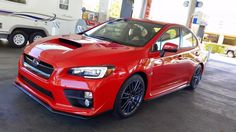 2015 Subaru WRX Limited (Lightning Red) with full STI underbody kit, STI turn signal mirrors and oem JDM wide angle heated glass, 18x8.5 (2010) STI Spec-C wheels, 245/40WR18