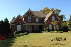 An all brick that Hubby might like.  4,145 sqft, 5 bedrooms, bridge, back stair, master down, etc.