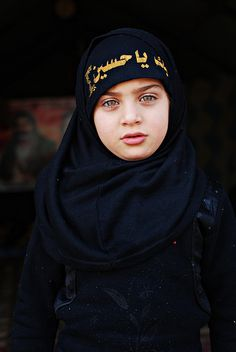 Young iraqi pilgrim A young Iraqi girl walking to Karbala in January 2012 for Arba'een. Arba'een is one of the largest pilgrimage gatherings on Earth, in which millions pilgrims travel to the city of Karbala in Iraq.