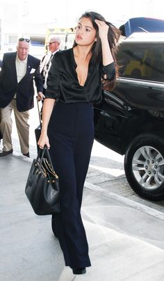 Selena Gomez Makes a Statement in a Plunging Blouse and High-Waisted Pants - Celebrity Street Style Fashion Mode, Womens Fashion, Street Fashion, Black Silk Blouse, Selena Gomez Style, Selena Gomez Outfits, All Black Looks, Style Couture, Style Outfits