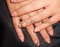 beige nails with black ribbon