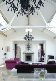 love the pop of magenta in a predominantly black and white room