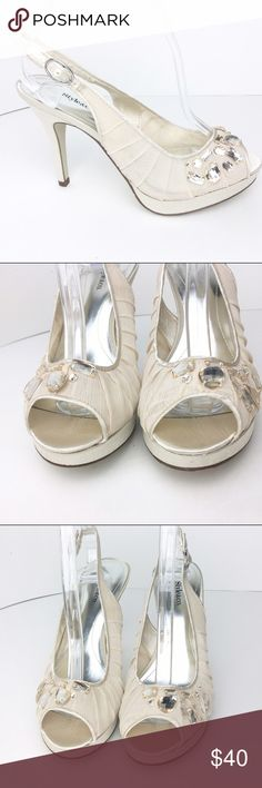 Style&Co Fabric & Jeweled Slingback Platform Heels Size 6 fabric color: cream w/ jewels. New with no box.  No known damage to Shoe. All items are authentic. We ship within 1-2 days. 🚫🚫No trades🚫🚫 💄💄💄Bundles are 10% off.  Use the new feature on the Poshmark app to create your own bundle with my listings💄💄💄 Style & Co Shoes Heels