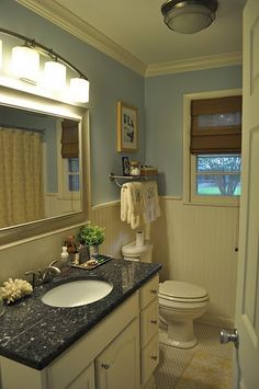 Pretty bathroom - love the monogrammed towels.