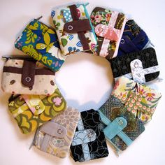 Noodlehead: Zippy Wallet Tutorial - How to make these ADORABLE little pouches that are zippered, lined, with a snap front pocket... really nice!!!!