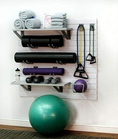 Home Fitness Kit The storeWALL Home Fitness Equipment Storage Kit helps you create your own home gym oasis. Hold yoga mats, free weights, towels, and resistance bands. Home Gym Garage, Diy Home Gym, Gym Room At Home, Home Gym Decor, Home Office, Cheap Home Gym, Small Home Gyms, Small Homes, Workout Room Home