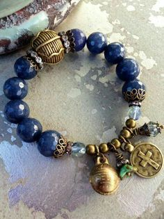 Denim Blue Sapphire Agate Stretch Charm Bracelet ~ Antique brass hardware ~ Cross Thai Brass Bell Charm Bracelet by Country Chic Charms Pandora Bracelets, Pandora Jewelry, Charm Jewelry, Boho Jewelry, Jewelry Crafts, Beaded Jewelry, Jewelry Bracelets, Jewelry Design, Geek Jewelry