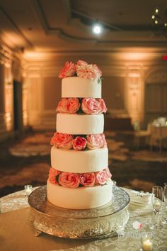 Tall cake layered with roses: http://www.stylemepretty.com/washington-dc-weddings/2015/05/22/romantic-ballroom-wedding-at-the-ritz-d-c/ | Photography: Readyluck - http://readyluck.com/