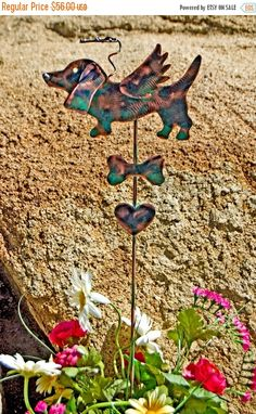"❘❘❙❙❚❚ ON SALE ❚❚❙❙❘❘     Basset hound garden art pet memorial grave marker garden plant stake by Garden Copper Art is accented with a halo suspended overhead, angel wings and bone and heart. This beloved dog angel would make a lovely heartfelt gift for any occasion. Available now for purchase. MEASUREMENTS: Please read measurement, thank you! ♥ Stake overall measures approximately 28"" in length including halo. ♥ Animal measures approximately 8 W from nose to rear X 4"" H from head to toe…"