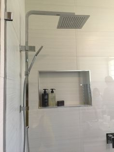 This full bathroom renovation transformed the room into a modern masterpiece. Great interior design with all the latest bathroom products from Highgrove Bathrooms. Frameless Shower Panel with Integrated Shower on Rail with Rain Shower Head and Hand Shower Combination. Shower Niches are a great bathroom storage option.