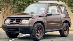 This 1996 Geo Tracker is a survivor that wears custom paint. With a genuine 37,800 miles on the clock, the owner offers it for sale with No Reserve. #Geo, #Tracker