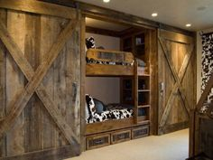 Building a wall of two sets of bunkbeds with dresser drawers between them would turn our Poker/Game room into a guest room with a sliding of the barn doors. We could also add 2 more beds by putting trundle beds beneath them. Hmmm... Good idea!