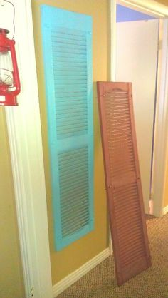 Plastic red shutters I picked up at a yard sale.... Spray painted it blue!!