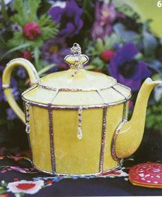Yellow vintage tea pot