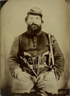ca. 1861-65, [tintype portrait of A. J. Blue, a heavily armed Union cavalry soldier with three Remington revolvers in his belt]
