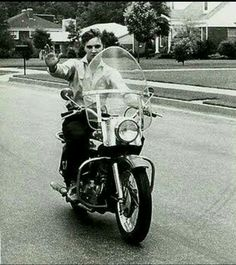 Elvis on his first 1956 Red  Harley Davidson motorcycle he purchased.