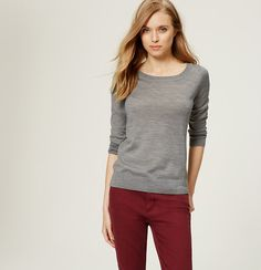 A row of back buttons intrigues this lightweight essential. Round neck. 3/4 sleeves. Banded neckline, cuffs and hem.