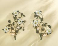 Price $26.65 - Magnolia candle wall sconces. Graceful twining metal branches arch behind magnolia blossoms; a pair of twinkling glass votives nestle among the deep green leaves. Painted metal. Tealights only not included. Pair. Each 13 34 x 3 x 16 12 high....