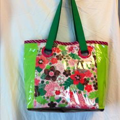 Spring handbag or purse design using clear vinyl over cotton prints. Has lots of pockets inside. Water bottle holder and magnetic closure.