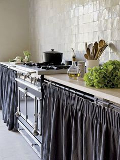 French Country Kitchen uses cabinet curtains instead of wood doors - it helps conserve trees - earth needs every tree she has to absorb carbon out of the air and store as trunks, branches and roots.