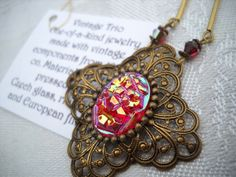 Vintage ruby glass scarab with ab luster coated by triolette, $15.99