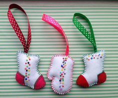 Set of 3 beautiful felt Christmas ornaments - two boots and a glove. These felt ornaments are hand embroidered and hand stitched. Will make cute