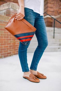 jeans and clutch via the college prepster