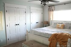 Gorgeous bedroom with plank walls and custom casing closet doors #masterbedroom #customclosets