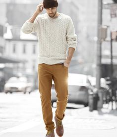 Rugged boots with rolled khakis and light sweater