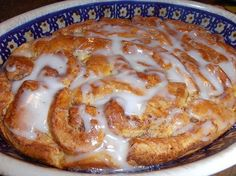 Cinnamon Roll Casserole  1 can/roll of cinnamon rolls (refrigerated biscuit section of store) 2 eggs 1/4 C. heavy cream 1 tsp. vanilla extract 2 T. corn syrup butter for greasing the pan  Heavily grease a casserole dish with the butter. Open the can of cinnamon rolls and unroll each one and cut the strips into 4 pieces. Place these strips in the bottom of your casserole dish. Whisk together the eggs, heavy cream, vanilla and corn syrup. Pour this evenly over the cinnamon roll strips. Using a…