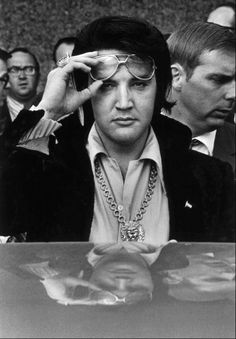 """On 12-31 in 1971: Elvis Presley announces to his entourage that his wife Priscilla will be divorcing him, saying simply, """"She says she doesn't love me anymore."""" In contrast to previous years, tonight's New Year's Eve celebration is held at Graceland rather than a local club."""