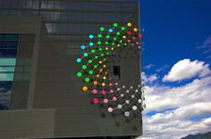 split spiral facade installation by ray king