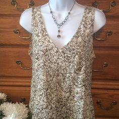 """Axcess By Liz Claiborne Soft Brown Tank Only wore it once.  100% cotton and in excellent condition. Colors of brown, taupe and creamy white. Approximately 23"""" in length and when measured laid flat from armpit to armpit it is 20"""" across.  There is a little stretch.  Can be worn dressed up or down with a great pair of jeans or white shorts.  Feels like a good Comfy T-shirt.  There is a 1"""" sewed panel  right under the bust line. Axcess By Liz Claiborne  Tops Tank Tops"""